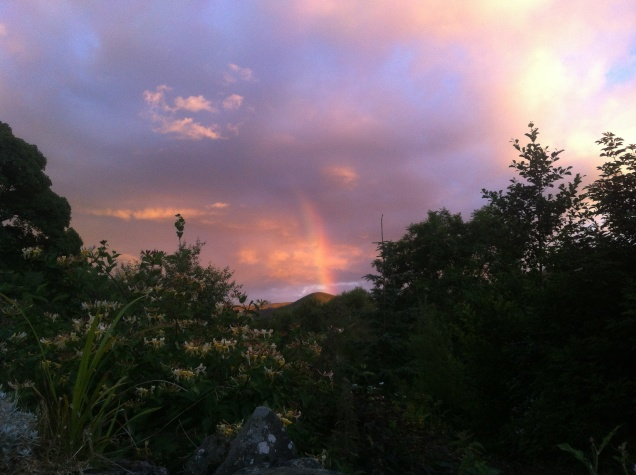 Sun and rain produce the rainbow and give life to the earth.